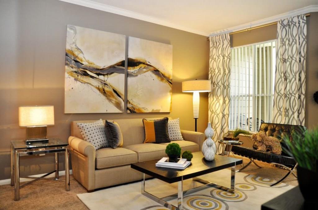 Диптих в интерьере современной гостиной комнаты