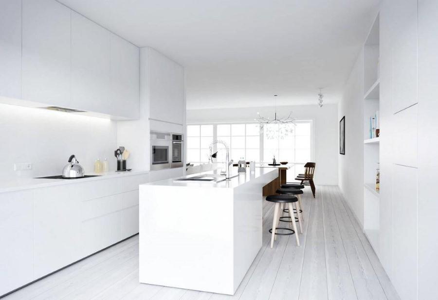 Белая встроенная мебель в кухне стиля минимализма