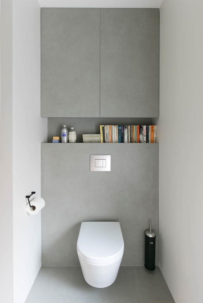 Серые дверки в стиле минимализма за унитазом