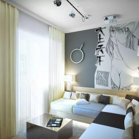 Небольшая комната с серыми стенами