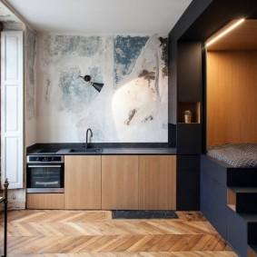 Спальной ложе в углу однокомнатной квартиры