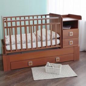 кроватка с пеленальным столиком фото оформление