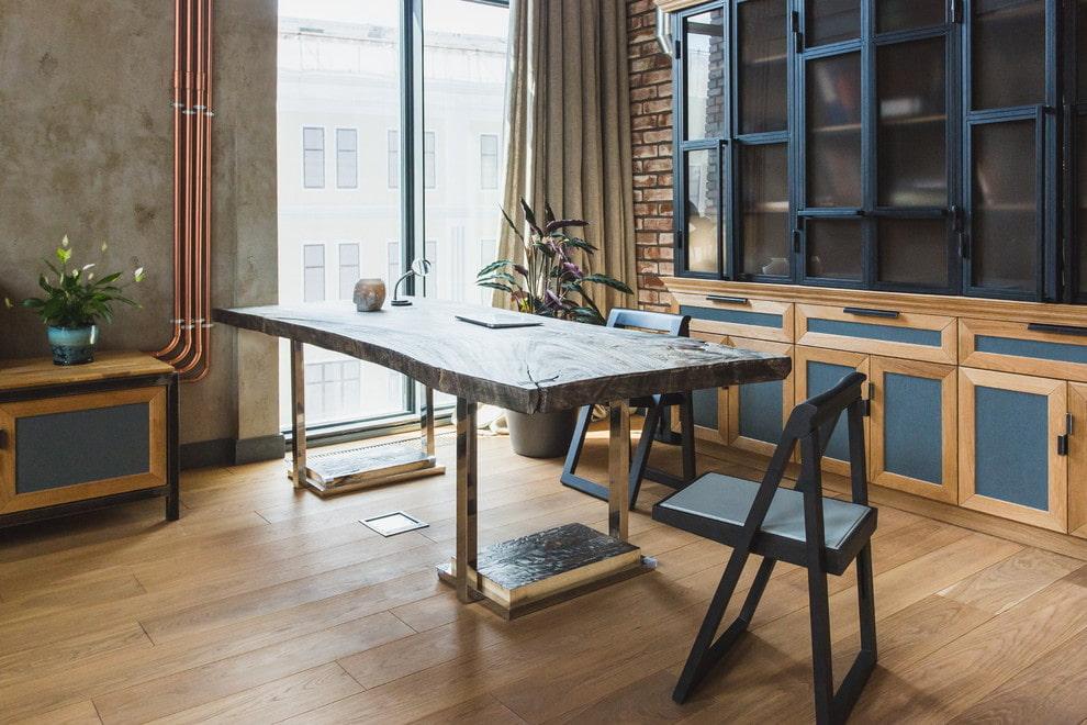 Дизайнерский стол в гостиной индустриального стиля