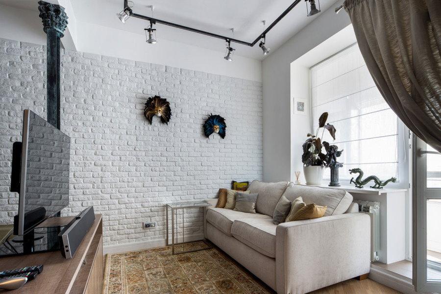 Имитация светлого кирпича с помощью обоев в гостиной