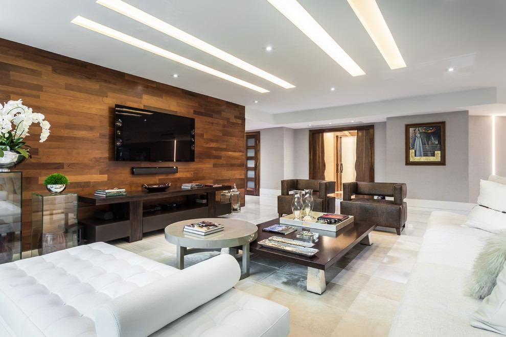 Зонирование просторной гостиной коричневым ламинатом
