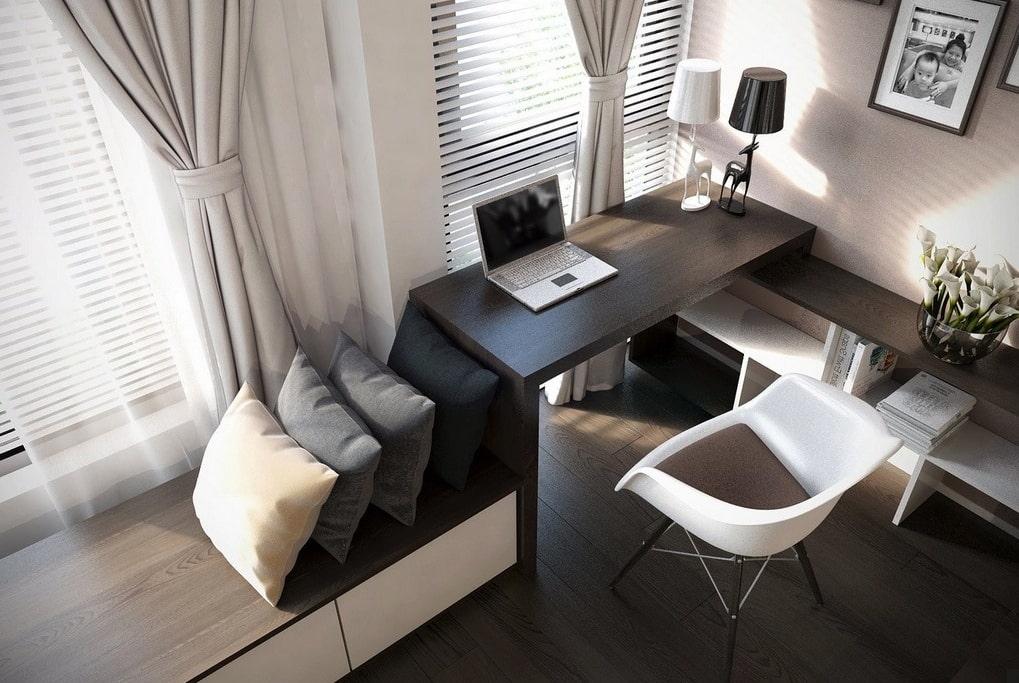 Рабочий стол с ноутбуком в углу гостиной