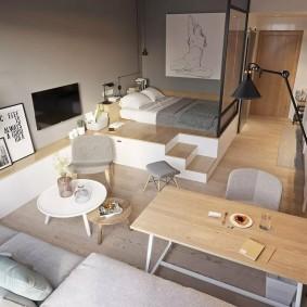 Спальное ложе на подиуме в маленькой квартире