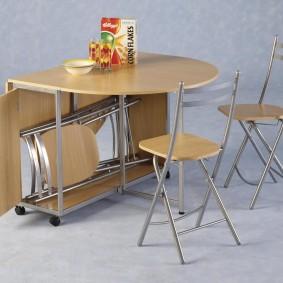Варианты раскладных столов-книжек в интерьер гостиных комнат
